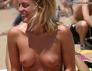 Dazzling blonde Topless above the Beach