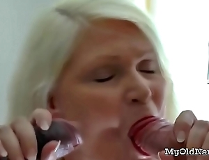 Busty granny fucked away from two dudes