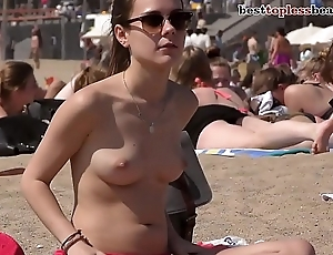 First-class brunette babe Topless above a difficulty Beach