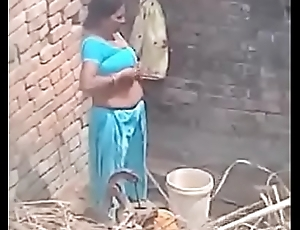 My Neighbor aunty Bathing showing her big boobs.