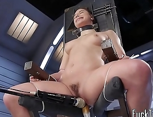 Tiedup machine babe enjoys cunt stretching